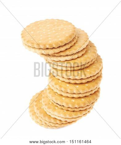 Twisted stack of round cookies with chocolate isolated over the white background