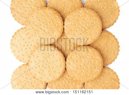 Pile of round cookies with the pieces of chocolate isolated over the white background