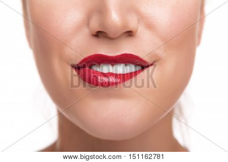 Sensuous woman biting red lips on white.