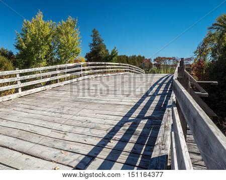 Old Wooden Bridge Over Rail Way In Autumn