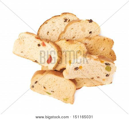 Pile of rusks with the pieces of dried fruits isolated over the white background
