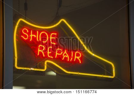 Neon sign colorful glowing bright shoe repair service