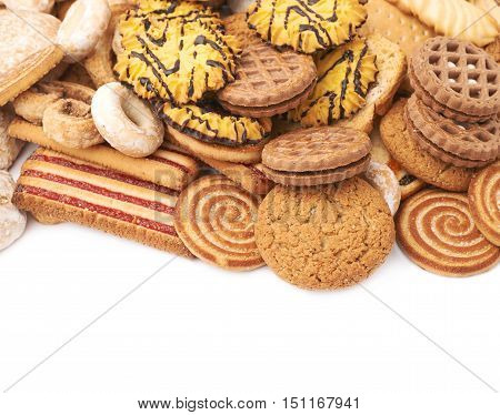Pile of different mix cookies isolated over the white background