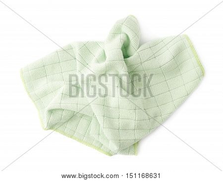 Green crumpled rag over white isolated background