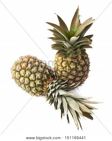Couple of whole raw fresh pineapples isolated over white background
