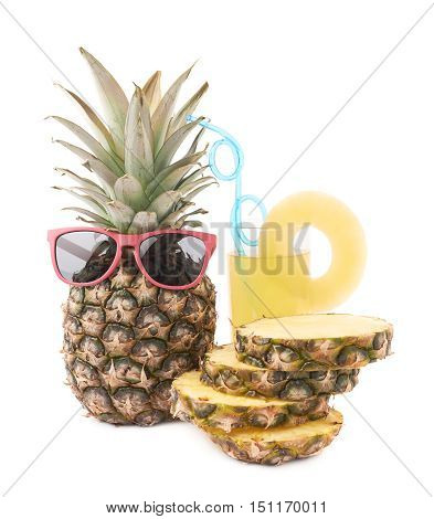 Whole raw fresh pineapple with glass of its juice isolated over white background