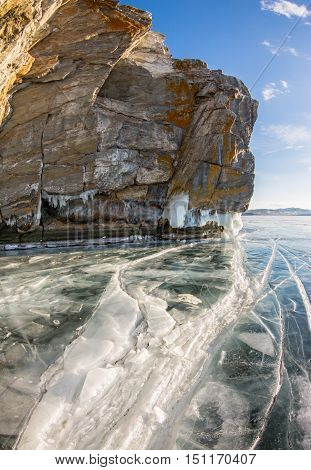 A Crack In The Ice And Ice Sokui On The Rock. Olkhon Island. Lake Baikal.