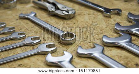 tools in tool belt on wood plankskeygarage