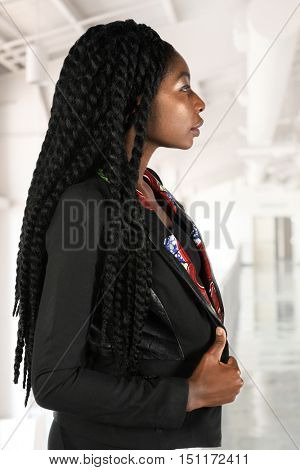 Portrait of beautiful African American businesswoman in profile view inside office