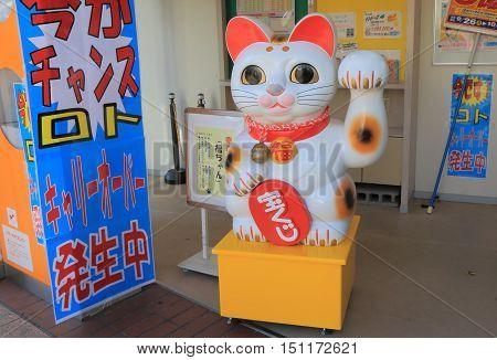 KANAZAWA JAPAN - OCTOBER 7, 2016: Japanese Manekineko Lucky cat stature in Kanazawa Japan
