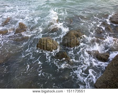 Rocky beach by the sea wave refreshing atmosphere