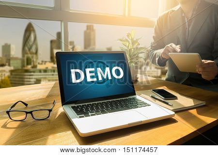 DEMO (Demo Preview Ideal) Thoughtful male person looking to the digital tablet screen laptop screenSilhouette and filter sun poster