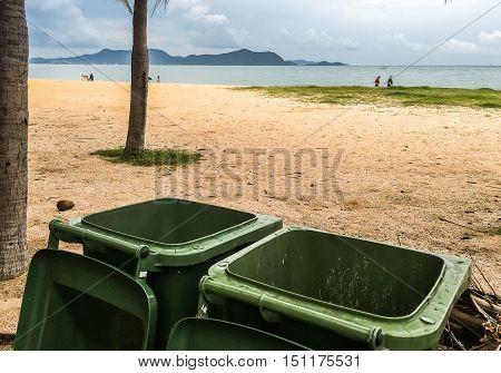Trash cans on beach, keep beach clean, save environment