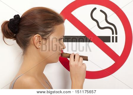 Woman. No smoking concept a no smoking sign