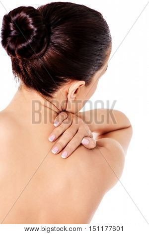 Picture of a woman touching her shoulder