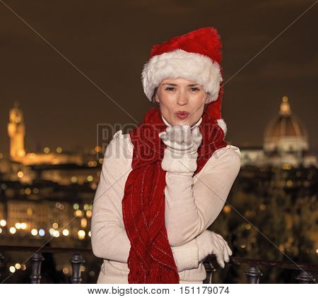 Woman In Christmas Hat At Piazzale Michelangelo Blowing Air Kiss