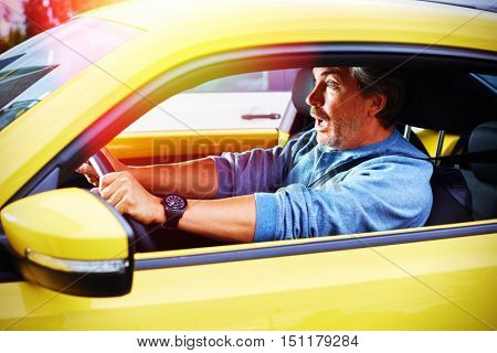 Stressed car driver man having accident on road.