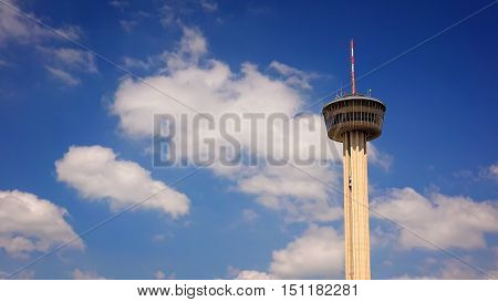 Tower of the Americas in San Antonio Texas against blue sky and clouds