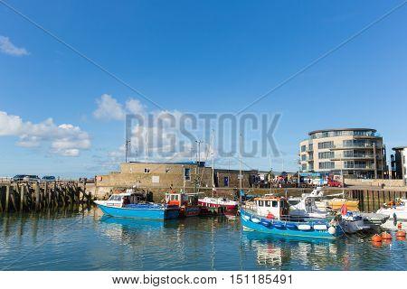 WEST BAY, DORSET, UK-SEPTEMBER 23rd 2016:  Fine calm late summer weather was enjoyed by visitors to West Bay harbour, Dorset, England, UK on Friday 23rd September 2016