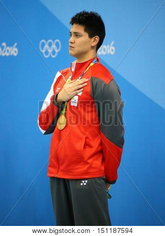 RIO DE JANEIRO, BRAZIL - AUGUST 12, 2016: Olympic Champion Joseph Schooling of Singapore during medal ceremony after Men's 100m butterfly of the Rio 2016 Olympics at the Olympic Aquatics Stadium