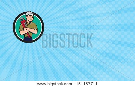 Business card showing Illustration of a plumber wearing hat looking to the side arms crossed holding monkey wrench viewed from front set inside circle on isolated background done in cartoon style.