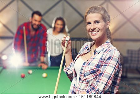 Picture showing group of friends playing billards