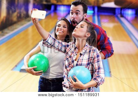 Picture showing friends playing bowling