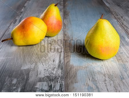 Pears on an old wooden table (close-up shot).