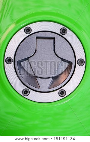 Fuel gas tank cap on green motorcycle