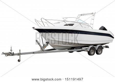 White boat on the trailer for transportation.