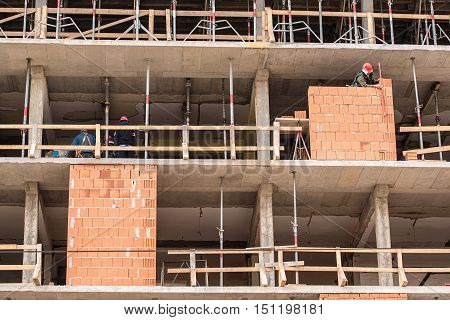 Workers On Construction