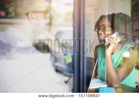 African Lady Talking Phone Concept