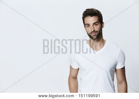 Man in white t-shirt in studio portrait