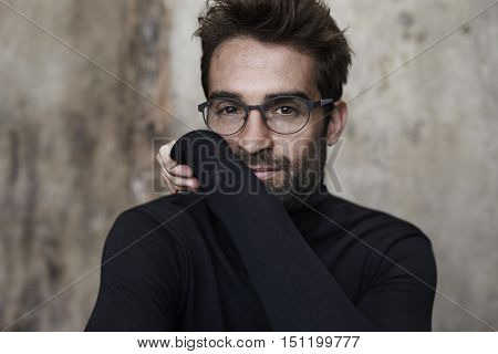 Spectacled guy in black sweater portrait -daylight