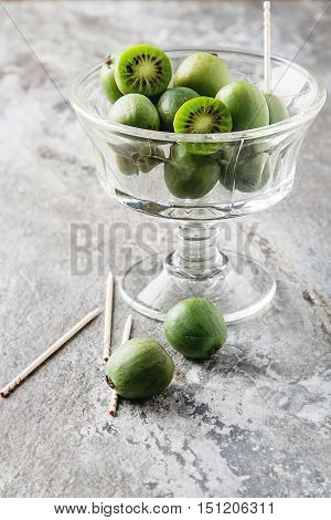 New Zealand Food. Berry Nergi, Or Small Kiwi. In The Glass. Grey