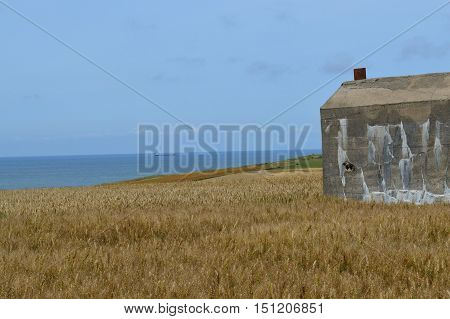 View along the coast of Nord France with part of a bunker used in WW II