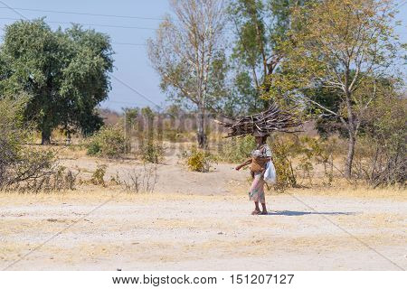 Caprivi, Namibia - August 20, 2016: Poor Woman Walking On The Roadside In The Rural Caprivi Strip, T