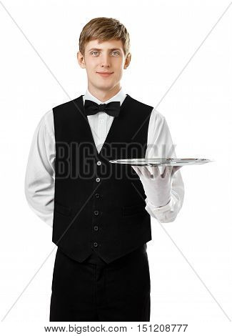 Portrait of young handsome waiter holding empty tray isolated on white background poster