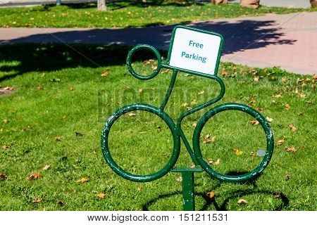 A Free Bicycle Parking sign in park