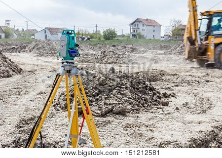 Surveyor engineer's equipment for measuring level on construction site. Surveyors ensure precise measurements before undertaking large construction projects.