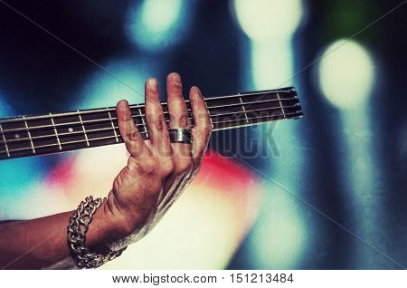 Rock bassist in concert vintage style photograph