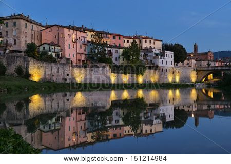 Old city reflection in Tevere river, Umbertide, Italy