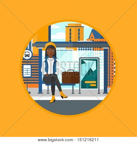 African-american woman with briefcase waiting for a bus at the bus stop on a city background. Young woman sitting at the bus stop. Vector flat design illustration in the circle isolated on background.