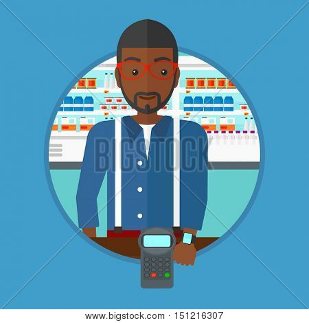 An african man paying wireless with his smart watch at the supermarket. Customer making payment for purchase with smart watch. Vector flat design illustration in the circle isolated on background.