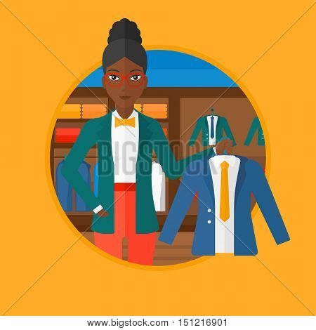 An african-american young woman holding hanger with suit jacket and shirt at clothing store. Shop assistant offering suit jacket. Vector flat design illustration in the circle isolated on background.