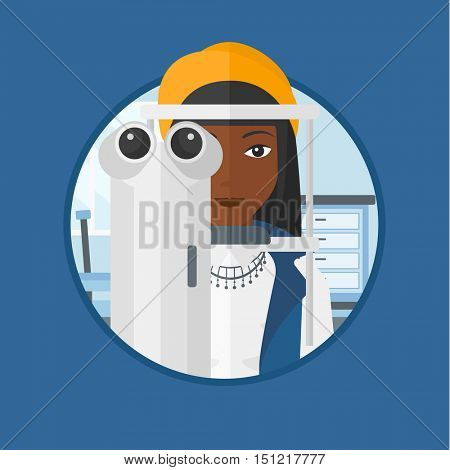African-american woman during an eye examination. Woman visiting optometrist. Woman undergoing medical examination at the oculist. Vector flat design illustration in the circle isolated on background.