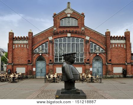 The Policeman statue (Toripolliisi) and the Market Hall on Market Square Oulu Finland