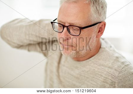 people, health, old age and problem concept - close up of  unhappy senior man suffering from neck ache
