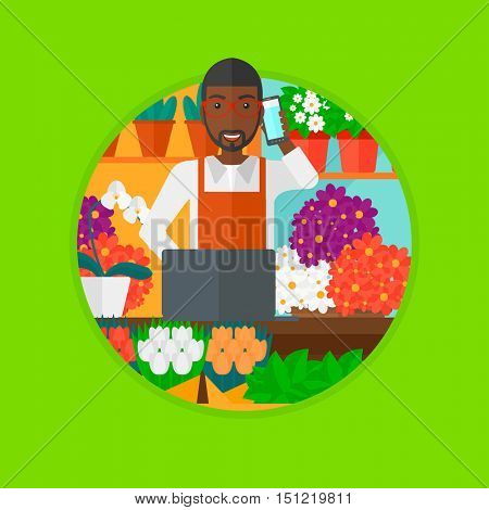 An african-american florist using telephone and laptop to take orders. A florist standing behind the counter at flower shop. Vector flat design illustration in the circle isolated on background.