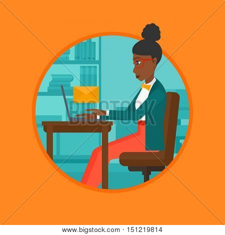 An african-american business woman working on laptop in office and receiving or sending email. Business technology, email concept. Vector flat design illustration in the circle isolated on background.